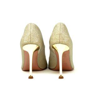 Décolleté Oro spuntato in tessuto glitterato, tacco a calice 10,5 cm e fondo in cuoio. Made in Italy